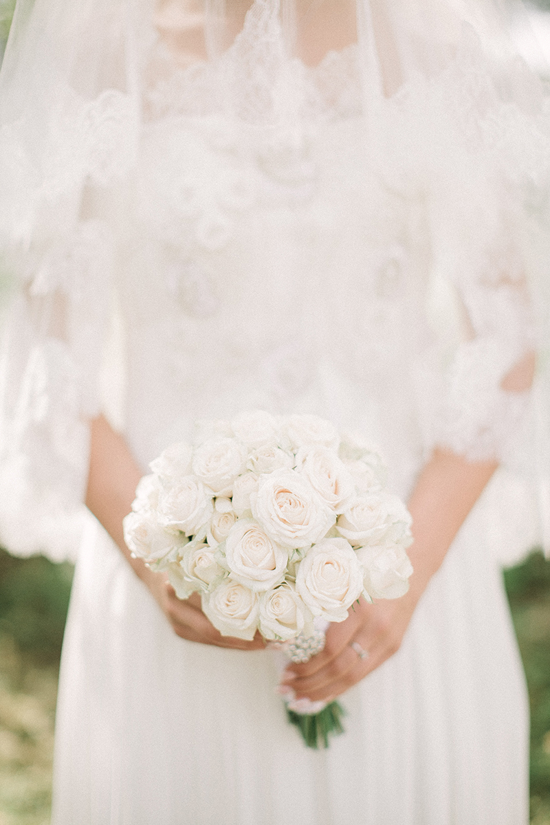 woman-wearing-white-wedding-gown-while-holding-bouquet-1533648